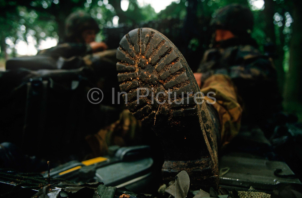 Detail of a British Army infantry soldiers boot during a lull in an infantry exercise on Salisbury Plain, on 5th August 1996, in Warminster, UK.