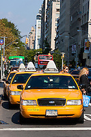 taxis on fifth avenue in New York City in October 2008