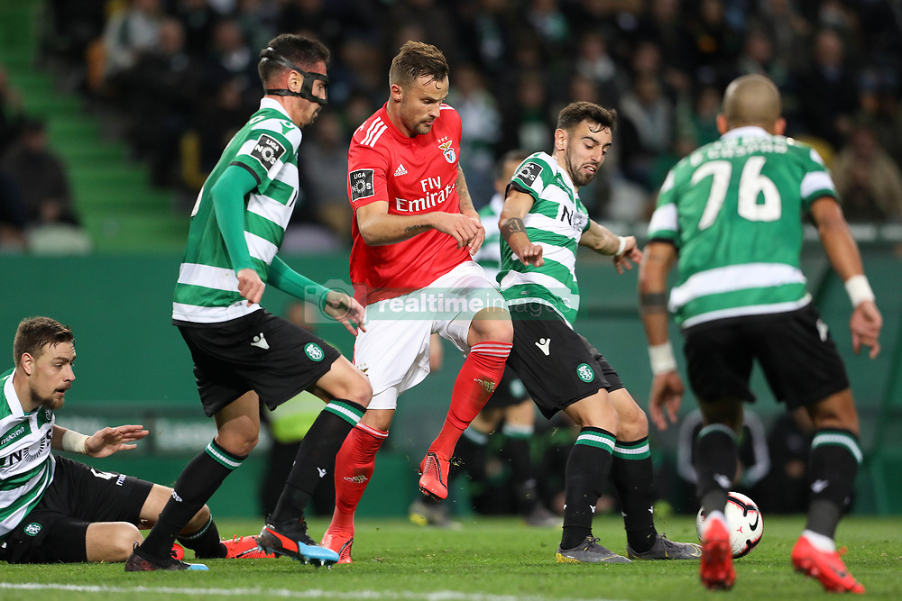 February 3, 2019 - Lisbon, PORTUGAL, Portugal - Haris Seferovic of SL Benfica (L) vies for the ball with Bruno Fernandes of Sporting CP (R) during the League NOS 2018/19 footballl match between Sporting CP vs SL Benfica. (Credit Image: © David Martins/SOPA Images via ZUMA Wire)