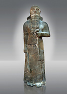 """Neo-Assyrian basalt statue of King Shalmaneser III (858-824 B.C) . Inscription reads """"Shalmaneser, the great king, the mighty king, king of all four region, the powerful and the mighty rival of the princes of the whole earth the great ones, the kings, son of Assur-Nasirapli, King of the universe, King of Assyria, grandson of ~Tukultiu-Ninurta, King of the Universe, King of Assyria"""". The inscription continues with his campaigns &b deeds in Uratu, Syria, Que & Tabal ending """" At the time I rebuilt the walls of my city Ashur from their foundations to their summits. I made an image of my royal self and set it up in the metal gate"""". From Assur ( Qala't Sharqat) Iraq. Istanbul Archaeological Museum, Inv no. 4650..<br /> <br /> If you prefer to buy from our ALAMY PHOTO LIBRARY  Collection visit : https://www.alamy.com/portfolio/paul-williams-funkystock/ancient-assyria-antiquities.html  Type -    Istanbul    - into the LOWER SEARCH WITHIN GALLERY box to refine search by adding background colour, place, museum etc<br /> <br /> Visit our ANCIENT WORLD PHOTO COLLECTIONS for more photos to download or buy as wall art prints https://funkystock.photoshelter.com/gallery-collection/Ancient-World-Art-Antiquities-Historic-Sites-Pictures-Images-of/C00006u26yqSkDOM"""