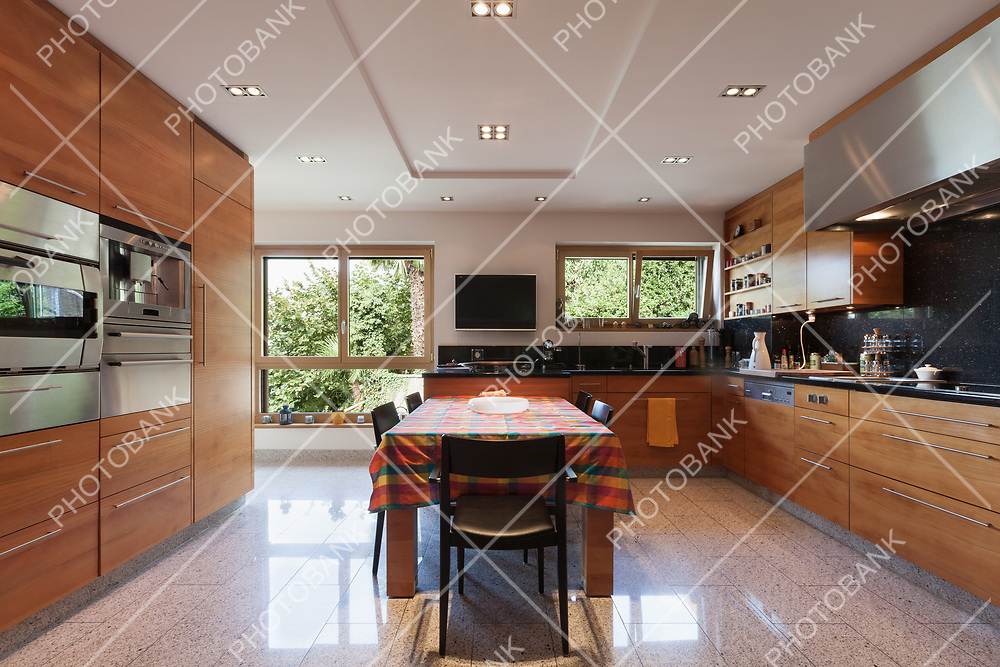 Interior of a modern apartment, wide domestic kitchen, cabinet with appliances