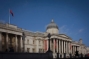 An exterior landscape of the classic architecture of the National Gallery in Trafalgar Square, central London.