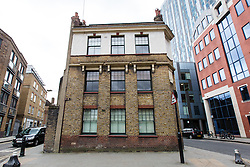 © Licensed to London News Pictures. 06/02/2016. London, UK. General view of 66-68 Bell Lane in Spitalfields, Tower Hamlets. Tracey Emin has submitted a planning application to demolish the building and replace it with a five-floor house connected to her studio. Heritage groups oppose the plans, claiming they are destructive and pose a threat to historic buildings in the conservation area. An appeal has been lodged by on behalf of Emin for a government planning inspector to have the final say. Photo credit : Vickie Flores/LNP