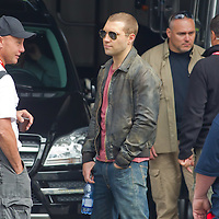 Actor Jai Courtney (C) of Australia costar of the fifth piece in the Die Hard series titled Good Day to Die Hard is seen among members of the crew during a shooting day in Budapest, Hungary on May 19, 2012. ATTILA VOLGYI