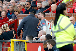 Liverpool's Jordan Henderson has words with Liverpool manager Jurgen Klopp after he's substituted for Xherdan Shaqiri (not in frame) during the Premier League match at Old Trafford, Manchester.
