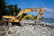 Diggers reinforcing the sea wall, St Thomas, Jamaica. (photo by Phil Clarke Hill/In Pictures via Getty Images)
