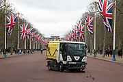 Vehicle vacuuming up horse manure along The Mall which is lined by Union Jack flags in Westminster on Brexit Day as the UK prepares to leave the European Union on 31st January 2020 in London, England, United Kingdom. At 11pm on Friday 31st January 2020, The UK and N. Ireland will officially leave the EU and go into a state of negotiations as to the future arrangement and trade agreement, while adhering to EU rules until the end of 2020.
