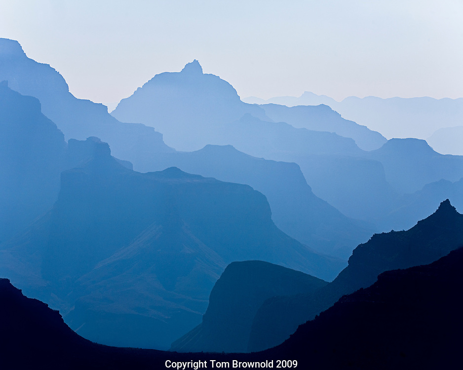 Looking East to the Desert Pallisade in through the late morning light and atmospheric haze in the Grand Canyon. The haze is created by the forest service control burns some distance to the south.