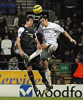 Photo: Paul Thomas.<br />Bolton Wanderers v Manchester City. The Barclays Premiership. 21/01/2006.<br />Man City's Robbie Fowler (L) battles in the air with Joey O'Brien.