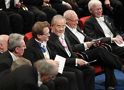 """Nobelpreisverleihung 2016 in der Konzerthalle in Stockholm / 101216 ***Japanese scientist Yoshinori Ohsumi (C) talks with other Nobel prize laureates during the award ceremony in Stockholm on Dec. 10, 2016. Ohsumi was awarded the Nobel prize in physiology or medicine for elucidating """"autophagy,"""" an intracellular process that degrades and recycles proteins."""