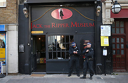 © Licensed to London News Pictures. 04/10/2015. London, UK. Police stand outside the Jack the Ripper Museum after a planned protest was cancelled as organisers feared a large amount of arrests. Photo credit: Peter Macdiarmid/LNP