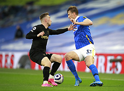 West Ham United's Jarrod Bowen (left) and Brighton and Hove Albion's Dan Burn battle for the ball during the Premier League match at the American Express Community Stadium, Brighton. Picture date: Saturday May 15, 2021.