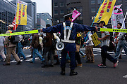Police control traffic and crowds at a demo march by left wing groups and anti-nuclear campaigners in Ginza, Tokyo, Japan Sunday November 6th 2011