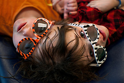 Craniopagus twins Tatiana and Krista Hogan wear sunglasses while preparing to have their teeth examined during a week of doctor's visits in Vancouver, British Columbia, Canada, March 4, 2011. Born Oct. 25, 2006 to parents Felicia Simms and Brendan Hogan, neurologists say the twins are the only such set that have a common neurological connection.