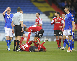 Bristol City's Marvin Elliott lies injured - Photo mandatory by-line: Joe Meredith/JMP - Tel: Mobile: 07966 386802 08/02/2014 - SPORT - FOOTBALL - Oldham - Boundary Park - Oldham Athletic v Bristol City - Sky Bet League One