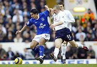 1/1/2005 - FA Barclays Premiership - Tottenham Hotspur v Everton - White Hart Lane<br />Tottenham Hotspur's goalscorer Dean Marney tussles with Everton's goalscorer Tim Cahill<br />Photo:Jed Leicester/Back Page Images