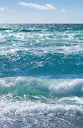 Waves surf breaking ocean shore turquoise