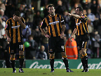 Photo: Lee Earle.<br /> Plymouth Argyle v Hull City. Coca Cola Championship. 09/12/2006.  Hull's John Welsh (L), Ian Ashbee (C) and Stuart Elliott (R) look dejected after Plymouth scored.