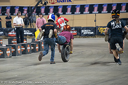 A fun race at the Flat Out Friday flat track racing on the Dr. Pepper-covered track in the UW-Milwaukee Panther Arena during the Harley-Davidson 115th Anniversary Celebration event. Milwaukee, WI. USA. Friday August 31, 2018. Photography ©2018 Michael Lichter.