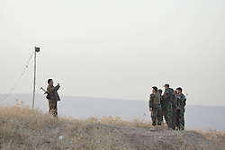 20/10/2016. Bashiqa, Iraq. Kurdish peshmerga fighters stand for a group photo taken by a colleague as they wait for the start of a joint Iraqi Army and peshmerga operation to retake Mosul from Islamic State militants today (20/10/2016).<br />
