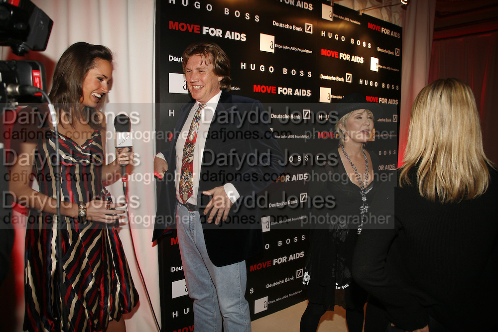 Theo Fennell and Lulu, MOVE FOR AIDS HOSTED BY ELLE MACPHERSON & DAVID FURNISH. Koko, Camden High St. London. 7/11/06. ONE TIME USE ONLY - DO NOT ARCHIVE  © Copyright Photograph by Dafydd Jones 66 Stockwell Park Rd. London SW9 0DA Tel 020 7733 0108 www.dafjones.com