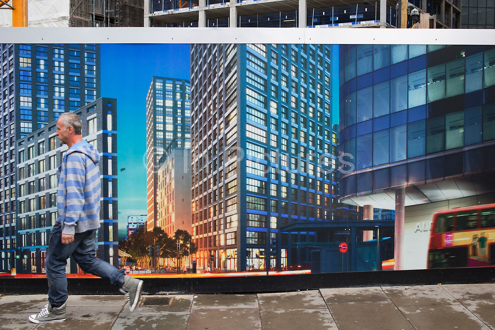 Architectural hoarding outside the construction site for a new block of apartments in London, England, United Kingdom. New offices blocks and flats are being built in Aldgate as the whole area is being regenerated. Other people see this type of large scale building work as simply the destruction of old London and increasing gentrification.