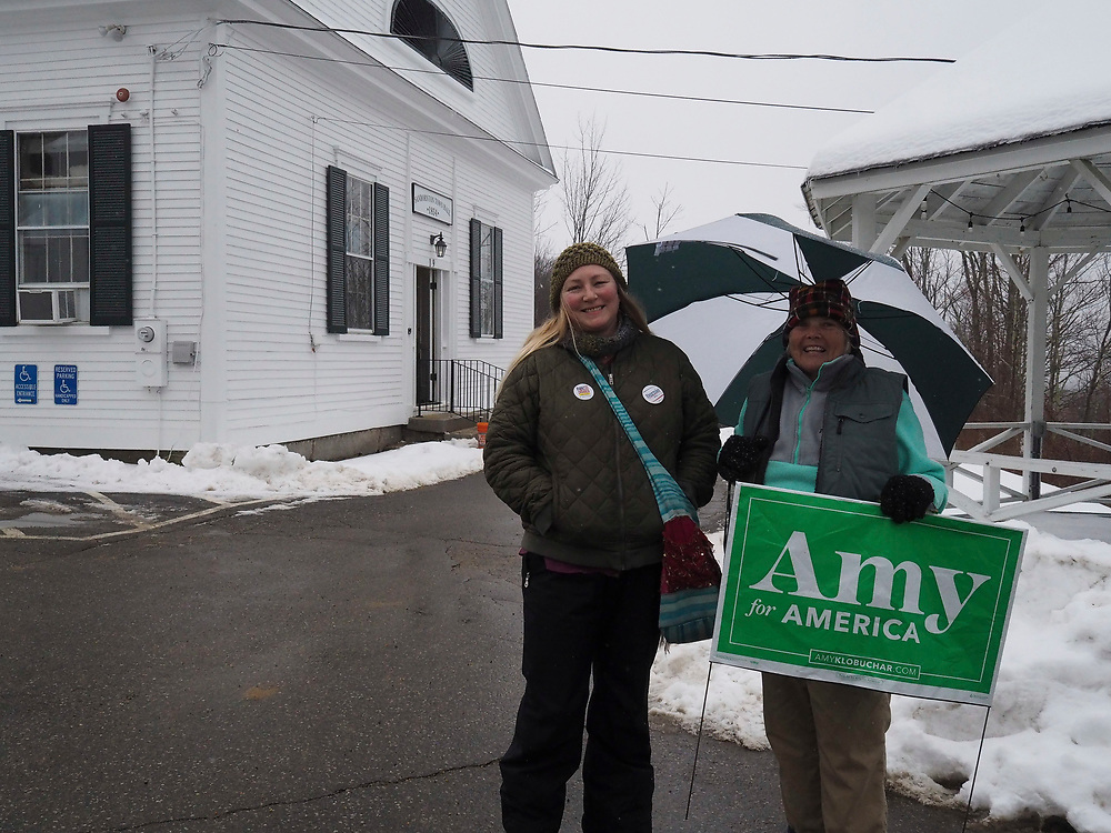 A Senator Amy Klobuchar supporter stands outside a New Hampshire polling site.