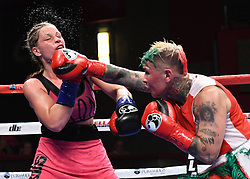May 5, 2018 - Mashantucket, CT, U.S. - MASHANTUCKET, CT - MAY 05: Edina Kiss  (blue tape)  battles Shelly Vincent  (red tape) during their bout on May 5, 2018 at the Foxwoods Fox Theater in Mashantucket, Connecticut. Shelly Vincent defeated Edina Kiss via decision. (Photo by Williams Paul/Icon Sportswire) (Credit Image: © Williams Paul/Icon SMI via ZUMA Press)