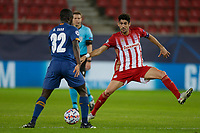 PIRAEUS, GREECE - DECEMBER 09: Malang Sarr of FC Porto and Andreas Bouchalakis of Olympiacos FC during the UEFA Champions League Group C stage match between Olympiacos FC and FC Porto at Karaiskakis Stadium on December 9, 2020 in Piraeus, Greece. (Photo by MB Media)