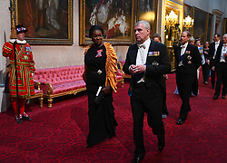 Dame Vivien Hunt and the Duke of York arrive through the East Gallery during the State Banquet at Buckingham Palace, London, on day one of the US President's three day state visit to the UK.