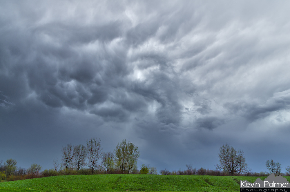 After a severe thunderstorm passed through Snakeden Hollow, it looked like mammatus clouds were trying to form.<br /> <br /> Date Taken: April 28, 2014