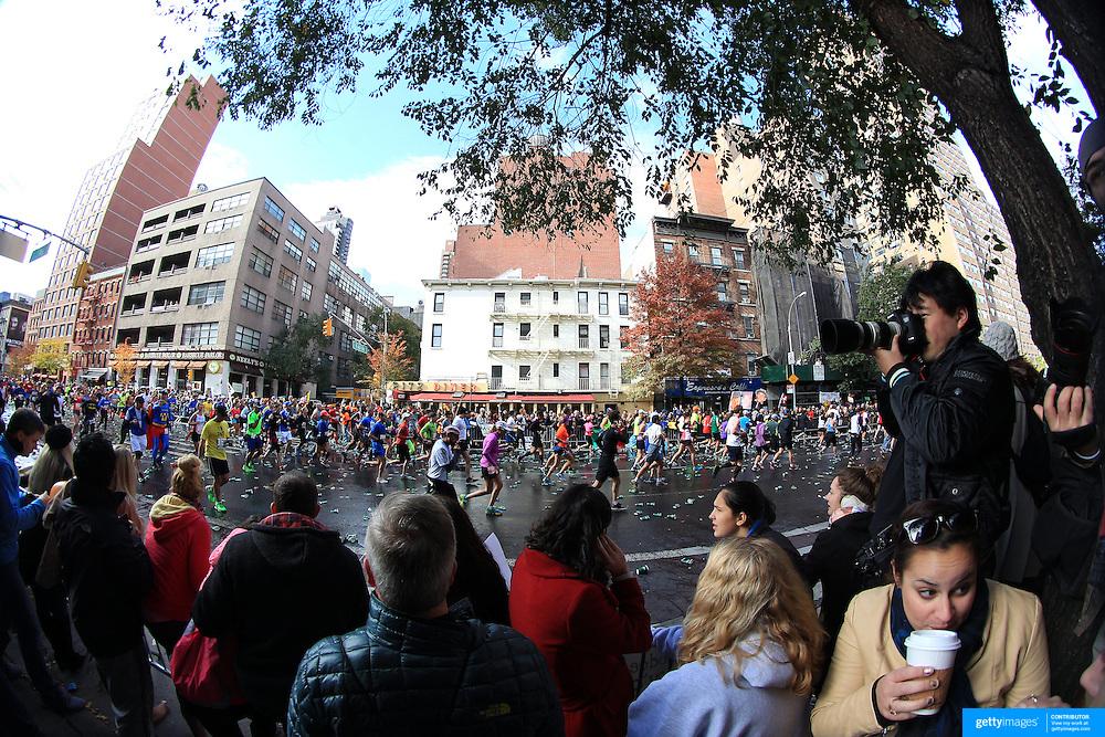 Spectators encourage runners make their way along First Avenue in Manhattan, New York, during the ING New York Marathon. New York, USA. 3rd November 2013. Photo Tim Clayton