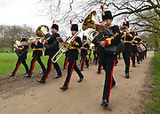 © Licensed to London News Pictures. 22/04/2013. London, UK The band of the Royal Artillery leave after the salute. The King's Troop Royal Horse Artillery fire a 41 Gun Royal Salute from Green Park at midday today 22 April 2013, in honour of Her Majesty Queen Elizabeth II 87th Birthday. Photo credit : Stephen Simpson/LNP