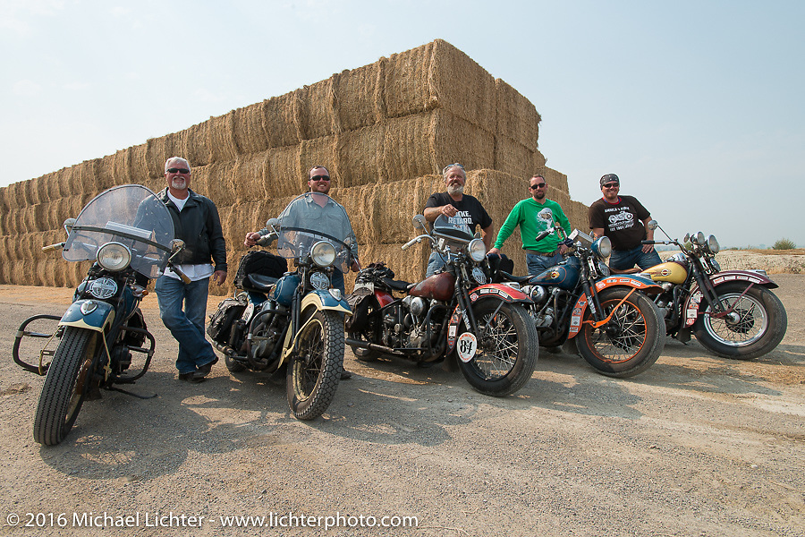 """Left to right - Ken McManus with his 1936 Harley-Davidson Knucklehead, Matt McManus on an exactly identical machine, Carl Olsen with his 1936 Harley-Davidson Knucklehead, Scott Wages, the """"Golden Ticket"""" winner who won the opportunity to ride the entire Cannonball on this 1936 Harley-Davidson Knucklehead from Carl's Cycle and Jason Sims on another Carl's Cycle 1939 Harley-Davidson Knucklehead during stage 13 (257 miles) of the Motorcycle Cannonball Cross-Country Endurance Run, which on this day ran from Elko, NV to Meridian, Idaho, USA. Thursday, September 18, 2014.  Photography ©2014 Michael Lichter."""