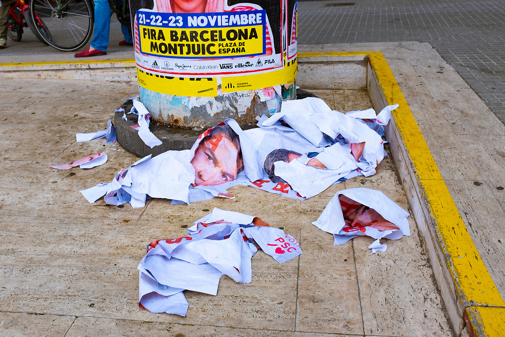 Socialist election posters showing Prime Minister Pedro Sanchez torn down and ripped up on the streets of Sant Cugat. Sanchez is not a popular figure in Catalonia after recent heavy handed police violence against people protesting against the jailing of politicians and civil society leaders for their part in the 2017 independence referendum.