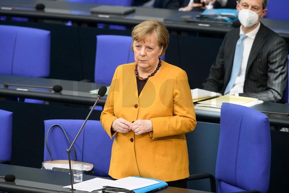 24 MAR 2021, BERLIN/GERMANY:<br /> Angela Merkel, CDU, Bundeskanzlerin, waehrend der Regierungsbefragung durch den Bundestag zur Bekaempfung der Corvid-19 Pandemie, Plenarsaal, Reichstagsgebaeude, Deutscher Bundestag<br /> IMAGE: 20210324-01-031<br /> KEYWORDS: Corona