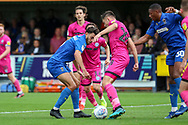 AFC Wimbledon defender Will Nightingale (5) battles for possession with Rochadale midfielder Aaron Morley (28) during the EFL Sky Bet League 1 match between AFC Wimbledon and Rochdale at the Cherry Red Records Stadium, Kingston, England on 5 October 2019.