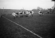 Roger Pickering, English scrum half, kicks to touch as the Irish forwards close in after a line out, ..Irish Rugby Football Union, Ireland v England, Five Nations, Landsdowne Road, Dublin, Ireland, Saturday 11th February, 1967,.11.2.1967, 2.11.1967,..Referee- D M Hughes, Welsh Rugby Union, ..Score- Ireland 3 - 8 England, ..Irish Team, ..T J Kiernan,  Wearing number 15 Irish jersey, Full Back, Cork Constitution Rugby Football Club, Cork, Ireland,..D Scott, Wearing number 14 Irish jersey, Right Wing, Queens University Rugby Football Club, Belfast, Northern Ireland, ..F P K Bresnihan, Wearing number 13 Irish jersey, Right Centre, University College Dublin Rugby Football Club, Dublin, Ireland, ..J C Walsh,  Wearing number 12 Irish jersey, Left Centre, Sundays Well Rugby Football Club, Cork, Ireland, ..N H Brophy, Wearing number 11 Irish jersey, Left wing, Blackrock College Rugby Football Club, Dublin, Ireland, ..C M H Gibson, Wearing number 10 Irish jersey, Stand Off, N.I.F.C, Rugby Football Club, Belfast, Northern Ireland, ..B F Sherry, Wearing number 9 Irish jersey, Scrum Half, Terenure Rugby Football Club, Dublin, Ireland, ..K G Goodall, Wearing number 8 Irish jersey, Forward, Newcastle University Rugby Football Club, Newcastle, England, ..M G Doyle, Wearing number 7 Irish jersey, Forward, Edinburgh Wanderers Rugby Football Club, Edinburgh, Scotland, ..N Murphy, Wearing number 6 Irish jersey, Captain of the Irish team, Forward, Cork Constitution Rugby Football Club, Cork, Ireland,..M G Molloy, Wearing number 5 Irish jersey, Forward, University College Galway Rugby Football Club, Galway, Ireland,  ..W J McBride, Wearing number 4 Irish jersey, Forward, Ballymena Rugby Football Club, Antrim, Northern Ireland,..P O'Callaghan, Wearing number 3 Irish jersey, Forward, Dolphin Rugby Football Club, Cork, Ireland, ..K W Kennedy, Wearing number 2 Irish jersey, Forward, C I Y M S Rugby Football Club, Belfast, Northern Ireland, ..T A Moroney, Wearing number 1 Irish jersey, Forwar