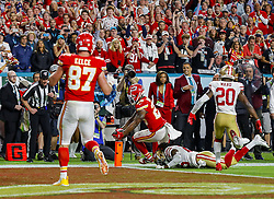 February 2, 2020, Miami Gardens, FL, USA: Kansas City Chiefs running back Damien Williams (26) scores a touchdown on a 5-yard pass reception against the San Francisco 49ers during the fourth quarter of Super Bowl LIV at Hard Rock Stadium in Miami Gardens, Fla., on Sunday, Feb. 2, 2020. The Chiefs won, 31-20. (Credit Image: © TNS via ZUMA Wire)