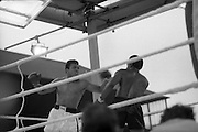 Ali vs Lewis Fight, Croke Park,Dublin..1972..19.07.1972..07.19.1972..19th July 1972..As part of his built up for a World Championship attempt against the current champion, 'Smokin' Joe Frazier,Muhammad Ali fought Al 'Blue' Lewis at Croke Park,Dublin,Ireland. Muhammad Ali won the fight with a TKO when the fight was stopped in the eleventh round...A snarling Ali swings a left which Lewis sidesteps to avoid.