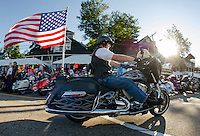 The 23rd anniversary POW/MIA Freedom Ride makes it's way down Lakeside Avenue Thursday evening.  (Karen Bobotas/for the Laconia Daily Sun)