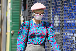 © Licensed to London News Pictures. 09/05/2020. London, UK. A woman wearing a face covering in north London on what could be he hottest day of the year so far. Prime Minister Boris Johnson is set to announce on Sunday, 10 May, measures to ease coronavirus lockdown, which was introduced on 23 March to slow the spread of the COVID-19. Photo credit: Dinendra Haria/LNP