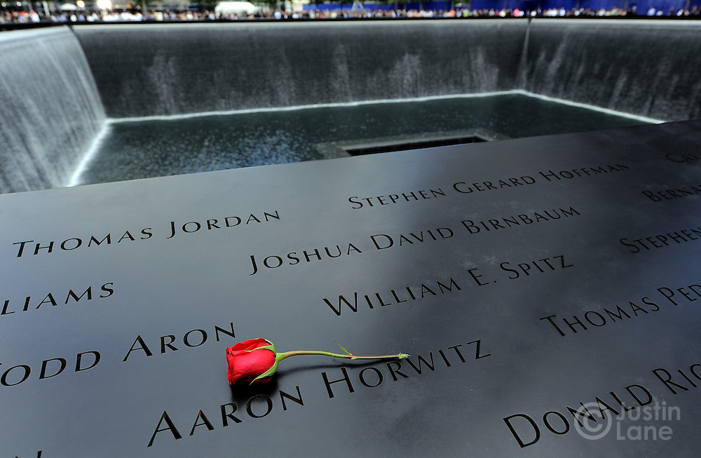 A view of a rose on the names inscribed around the North Pool of the 9/11 Memorial during tenth anniversary ceremonies at the site of the World Trade Center September 11, 2011, in New York. POOL/Justin Lane/EPA