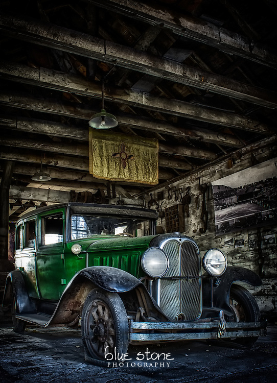 An antique automobile that is parked inside a wooden structure with mining artifacts represents the dichotomy between the life of a miner and the wealthy.<br /> <br /> Wall art is available in metal, canvas, float wrap and standout. Art prints are available in lustre, glossy, matte and metallic finishes.
