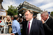 Shadow Education Secretary Ed Balls arrives for a rally and protest about the proposed cuts in the building of Schools at Methodist Hall, Westminster, London.