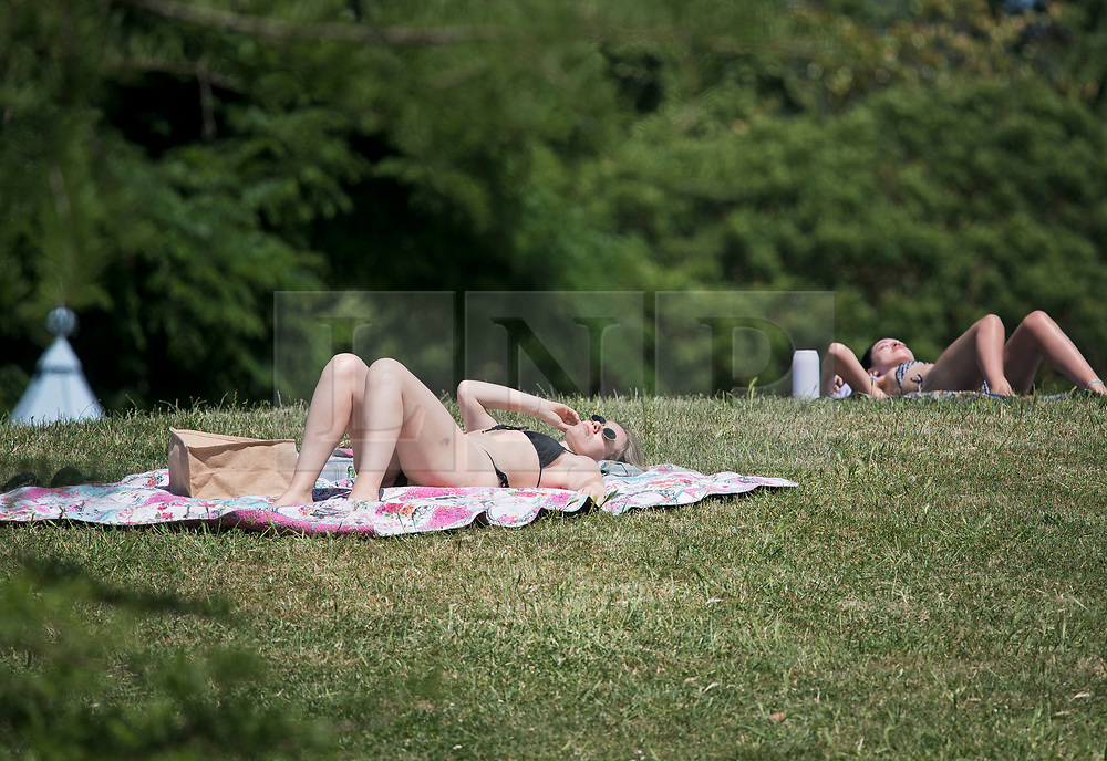© Licensed to London News Pictures. 16/06/2021. London, UK. A woman sunbathing in warm weather in Battersea Park, south London. Temperatures in the capital are expected to reach in to the late 20 degrees again today, with rain predicted for the coming days.. Photo credit: Ben Cawthra/LNP