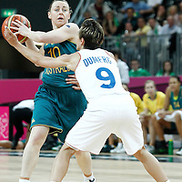 30 July 2012: Kristi Harrower of Australia looks to pass the ball past Celine Dumerc of France during the 74-70 Team France overtime victory over Team Australia, during the women's basketball preliminary, at the Basketball Arena, in London, Great Britain.