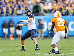 Sep 1, 2018; Charlotte, NC, USA; West Virginia Mountaineers quarterback Will Grier (7) passes the ball during the third quarter against the Tennessee Volunteers at Bank of America Stadium. Mandatory Credit: Ben Queen-USA TODAY Sports