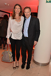 TOM BRADBY and his wife CLAUDIA BRADBY at the Costa Book Awards 2013 held at Quaglino's, 16 Bury Street, London on 28th January 2014.