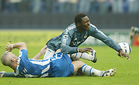 Photo: Aidan Ellis.<br /> Wigan Athletic v Newcastle United. The Barclays Premiership. 15/10/2005.<br /> Wigan's Graham kavanagh brings down Newcastle's Shola Ameobi